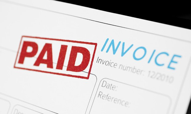 "An invoice with a ""paid"" stamp on it. Photo: Raphael Daniaud/iStockphoto.com"