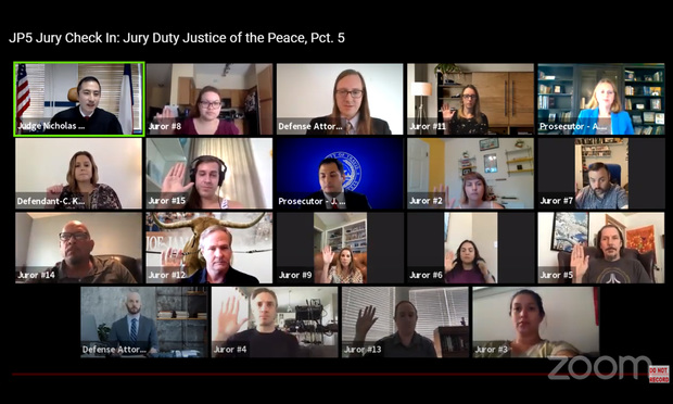 Potential jurors raise their right hand to take the oath at the beginning of jury duty in Travis County Justice of the Peace Pct. 5 Judge Nicholas Chu's court. It was the first fully virtual jury trial to take place in the nation on Tuesday, Aug. 11, 2020. (Photo: Courtesy Photo)