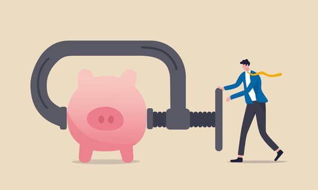 illustration of a businessman turning a vice on a piggy bank. Photo: eamesBot/Shutterstock.com