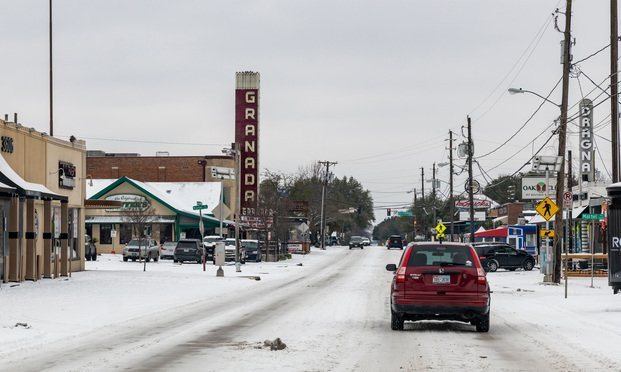 Lower Greenville Ave with Granada Theater in view during the recent snow storm and extreme cold weather in Dallas, Texas. February 17, 2021. Credit: jmanaugh3/Shutterstock.com