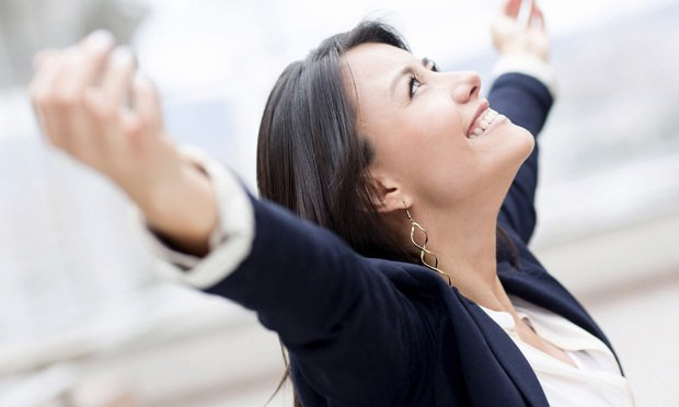 Business-woman-smiling-with-arms-out