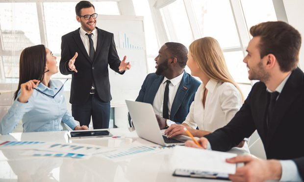Business people discussing in a meeting. Talking, speech, smiling, happy