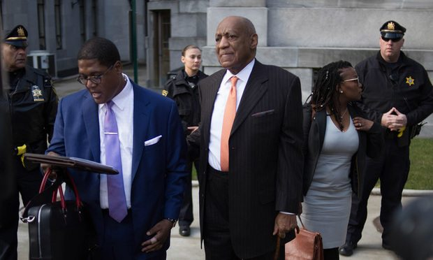 Actor Bill Cosby, right, and spokesman Andrew Wyatt