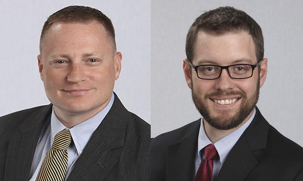 Joshua Lorenz, left, and Brandon Rothey, right, of Meyer Unkovic & Scott.