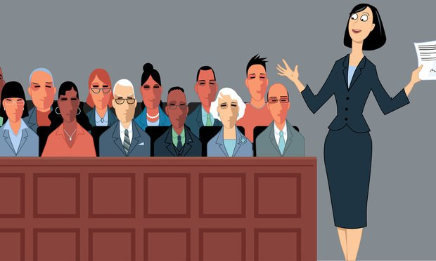 Female attorney address the jury at a trial