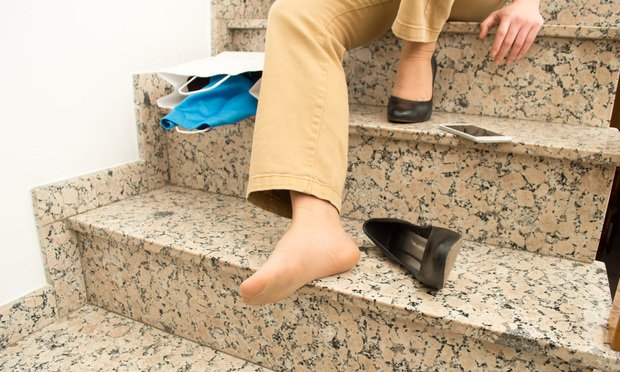 Woman falling down on stairs.