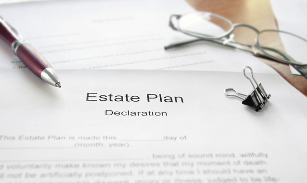 An Estate Plan document on a desk with glasses and pen