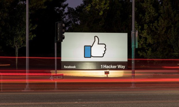 Facebook sign at night.