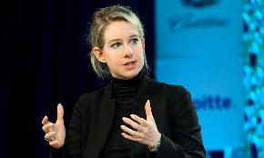 SEC Charges Theranos CEO Holmes and Former President With Investor Fraud