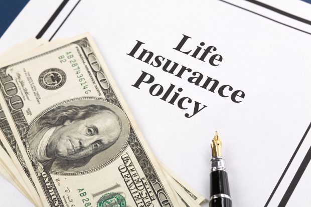 Life Insurance policy with money and a pen