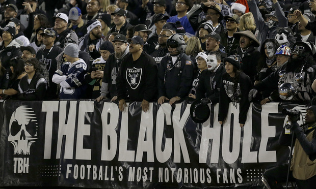 Fans watch from The Black Hole end zone at Oakland Alameda County Coliseum during the first half of an NFL football game between the Oakland Raiders and the Dallas Cowboys in Oakland, Calif., Sunday, Dec. 17, 2017. (AP Photo/Ben Margot)