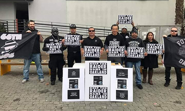 "Members of the fan group ""Forever Oakland"" holding ""Keep the Raider Name in Oakland"" shortly after the city filed suit against the Oakland Raiders and the NFL in December 2018. (Courtesy photo)"