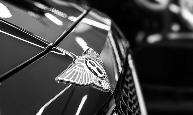 Bentley logo on the front of an automobile.