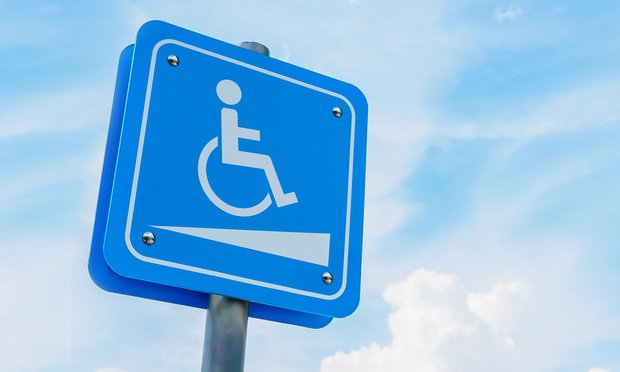 Handicapped parking sign.