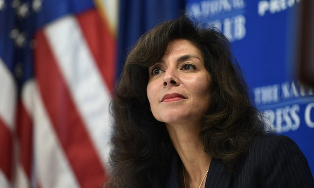 Ashley Tabaddor, a federal immigration judge in Los Angeles who serves as the President of the National Association of Immigration Judges, listens as she is introduced to speak at the National Press Club? in Washington, Friday, Sept. 21, 2018, on the pressures on judges and the federal immigration court system. (AP Photo/Susan Walsh)