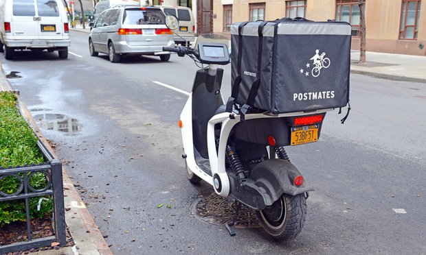 Scooter with a Postmates delivery box.
