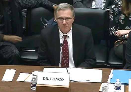 """Screenshot from a video featuring Dr. William Longo scientist with Materials Analytical Services, testifies before Subcommittee on Economic and Consumer Policy during a hearing entitled, """"Examining Carcinogens in Talc and the Best Methods for Asbestos Detection."""""""