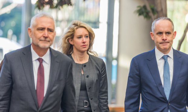 Elizabeth Holmes and attorneys from Williams & Connley head into the Northern District on Monday, January 13. (Photo: Jason Doiy/ALM)