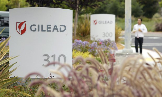 FILE - In this July 9, 2015, file photo, a man walks outside the headquarters of Gilead Sciences in Foster City, Calif. Gilead Sciences, Inc. reports financial results on Tuesday, Feb. 6, 2018. (AP Photo/Eric Risberg, File)