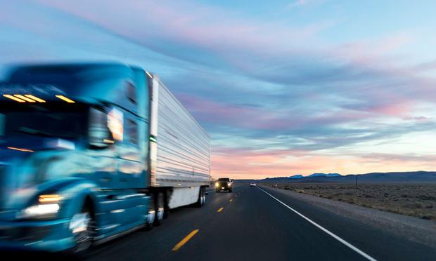 Blurred truck on a highway (Photo: Jason Doiy/ALM)