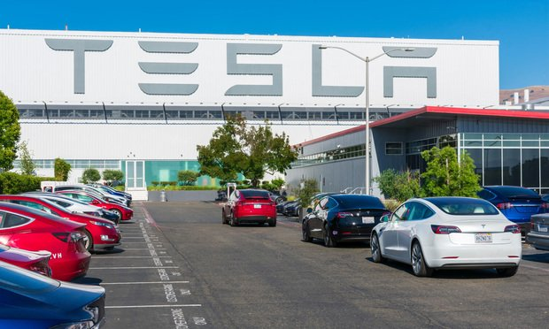 Tesla logo displayed on the exterior wall of the Tesla Factory in Fremont, CA.