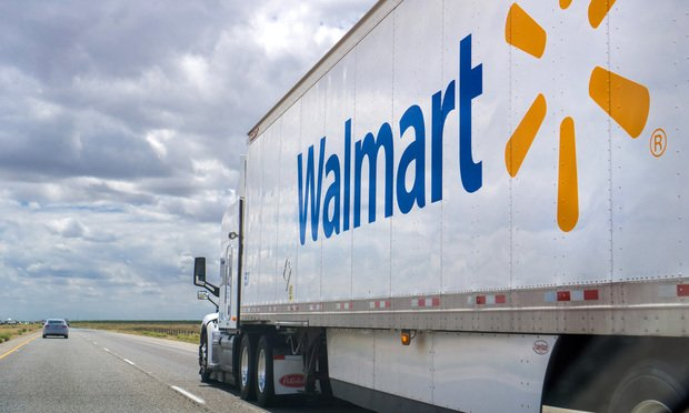 Walmart truck driving on the interstate.
