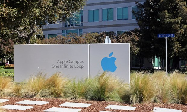 CUPERTINO, CA - MARCH 18: The Apple world headquarters located in Cupertino on March 18, 2014. Apple is a multinational corporation that produces consumer electronics, personal computers and software.