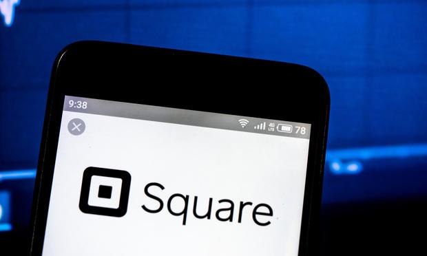 Square, Inc. company logo displayed on smartphone. (Photo: IgorGolovniov/Shutterstock.com)