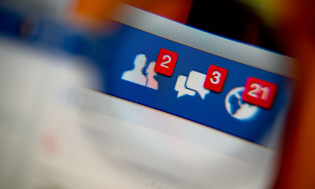 Facebook page with alerts for two Facebook friend invites, three messages and 21 notifications