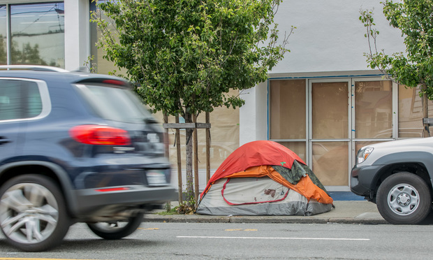 Tent on the sidewalk in San Francisco.