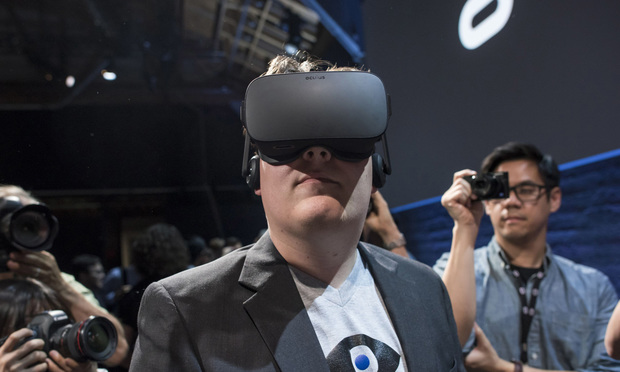 "Palmer Luckey, co-founder of Oculus VR Inc. and creator of the Oculus Rift, demonstrates the new Oculus Rift headset during the ""Step Into The Rift"" event in San Francisco, California, U.S., on Thursday, June 11, 2015. Facebook Inc.'s Oculus virtual-reality headsets will work with Microsoft Corp.'s Windows 10 and use the software maker's wireless Xbox game controller. Photographer: David Paul Morris/Bloomberg"
