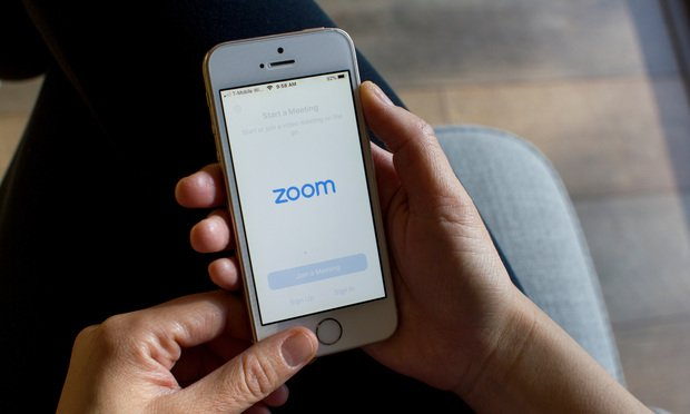 Portland, OR, USA - Mar 15, 2020: A woman opening the Zoom mobile app on her smartphone. Zoom users can opt to record sessions, collaborate on projects, and share or annotate on one another's screens. (Photo: Tada Images/Shutterstock)