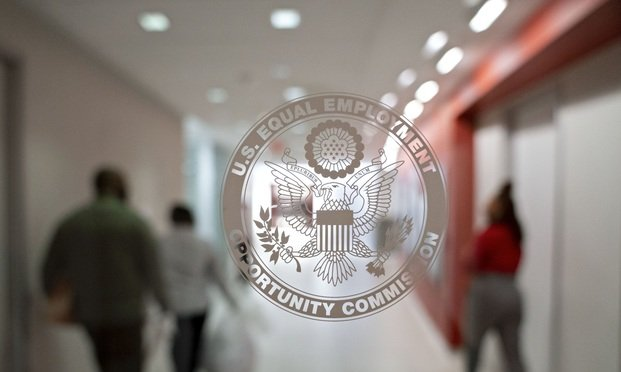 The Equal Employment Opportunity Commission (EEOC) seal is displayed on a window at the headquarters in Washington, D.C., U.S., on Tuesday, Feb. 18, 2020. The Trump administration wants to cut fiscal year 2021 spending on the Labor Department, National Labor Relations Board, and EEOC, reviving previous belt-tightening bids that have not been approved by Congress. Photographer: Andrew Harrer/Bloomberg