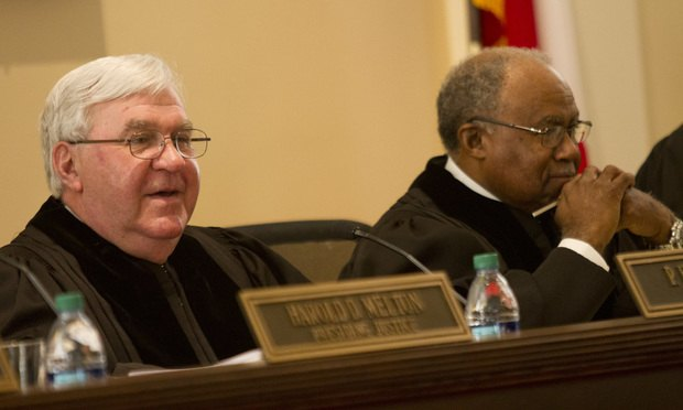 Chief Justice P. Harris Hines (left) and Justice Robert Benham of Supreme Court of Georgia in session at the University of Georgia School of Law