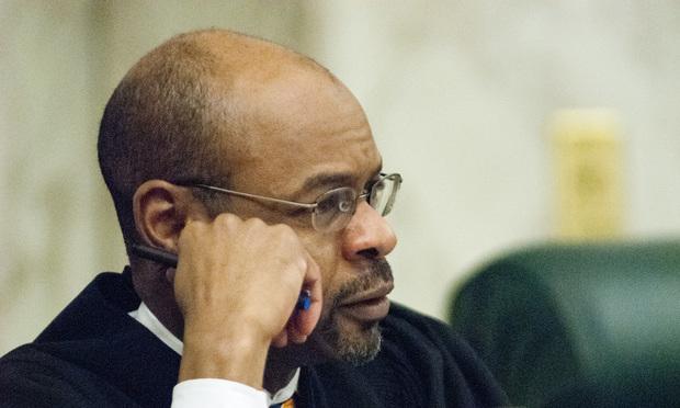 Justice Harold Melton