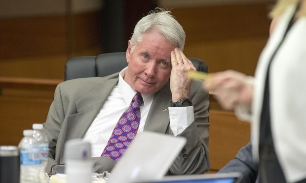 Tex McIver looks toward his defense attorney Amanda Clark Palmer during the second day of his trial before Fulton County Chief Judge Robert McBurney, Wednesday.
