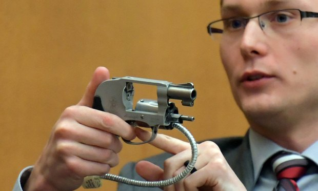 Zachary Weitzel, a GBI firearms examiner responsible for the forensic analysis of firearm evidence, demonstrates the workings of the Smith and Wesson .38 revolver, model 638 used in the shooting of Diane McIver.