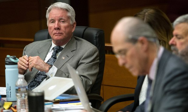Tex McIver (left) listens to testimony on Friday, the end of the second week of testimony in his murder trial at the Fulton County Courthouse.