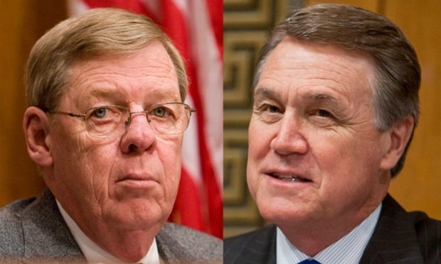 Georgia Sens. Johnny Isakson (left) and David Perdue