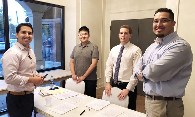 New immigration law clinic is a partnership between Emory Law, Kuck                     Baxter Immigration Partners, and Church of Jesus Christ of Latter Day Saints. Pictured during the inaugural clinic on August 8 at La Mansion Events Hall in Chamblee, are, from left, Jorge Gavilanes (Kuck Baxter), Jerry Zhang (3L), Tyler George (3L), and Uriel Delgado (Kuck Baxter)...