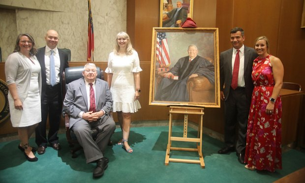 Tiffany Painter (from left), Blake Andrews, Judge Gary Andrews, Paige Andrews, Blane Andrews and Heather Andrews with Andrews' official portrait.