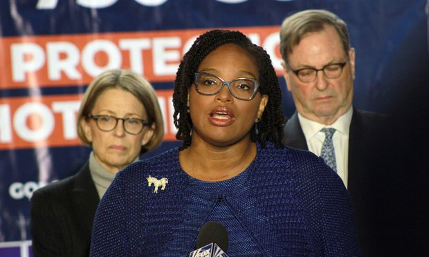 Allegra Lawrence-Hardy (center) flanked by legal team Elizabeth Tanis (left) and John Chandler. (Photo: John Disney/ALM)