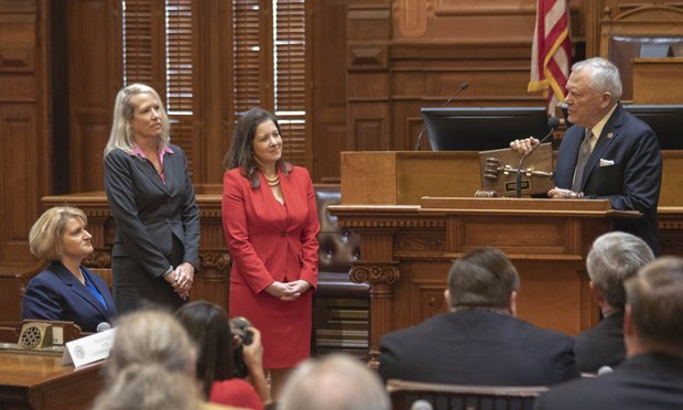 Newly sworn in judges (from left) Rachel Krause, Pandora Palmer and Emily Richardson, receive gavels from Gov. Nathan Deal. The gavel are made by inmates in the Georgia corrections system. (Photo: Bruce Shaw/ Administrative Office of the Courts)