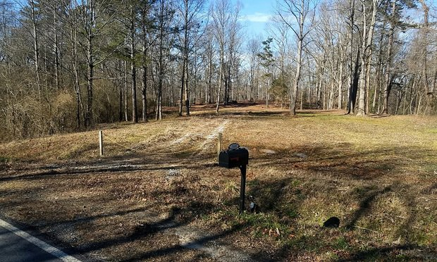 """Photo of a mailbox and no house—the """"address"""" of one of four voters who illegally voted in the House District 28 special election on Dec. 4, 2018, that led to the election being voided for the second time. (Courtesy photo)"""