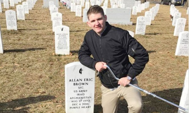 Winston Hencely, the plaintiff, at the grave of Army Sgt. 1st Class Allan Eric Brown (Courtesy photo)