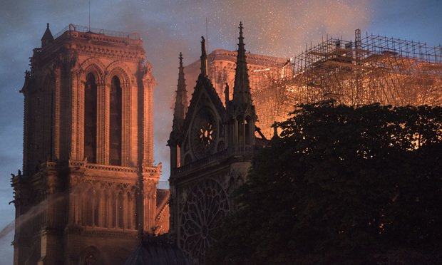 Flames and smoke rise from a fire at Notre Dame Cathedral in Paris on Monday. (Photo: Martin Barzilai/Bloomberg)