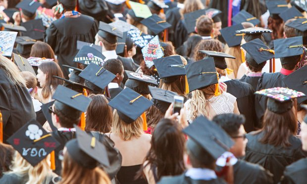 University of Georgia graduates wearing their mortarboards gather as they prepare for graduation activities in Athens. (Shutterstock.com)