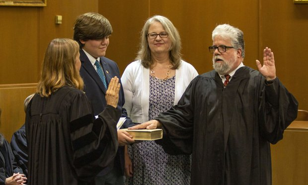 Judge Christopher McFadden takes the oath to become chief judge for the Georgia Court of Appeals. Judge Sara Doyle administered the oath while McFadden's wife, Gordon State College professor Lindy Hyde, and their son, Johnny, watched. (Courtesy photo: Bruce Shaw/Administrative office of the Courts Georgia)