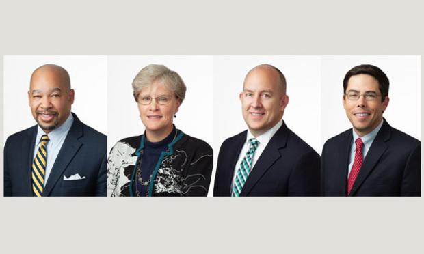 (l-r) William Hill Jr., Nancy Refuse, James Swartz Jr., and Stan Hill, with Seyfarth Shaw.