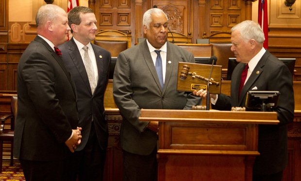 Gov. Nathan Deal, right, presents the newest judges of the Court of Appeals (from left), Tripp Self, Charlie Bethel and Clyde Reese, a handmade gavel made by inmates in the state prison system. Photo by John Disney/ALM